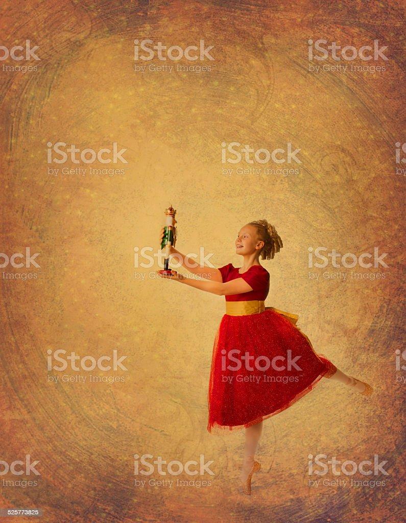Clara ballerina dances Nutcracker on gold background stock photo