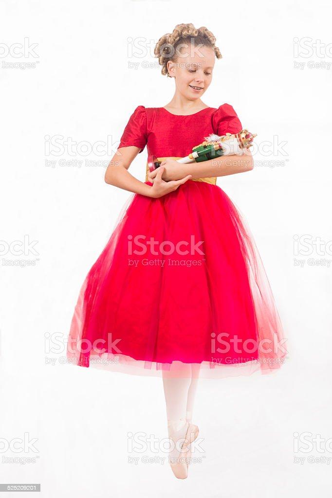 Clara en pointe with Nutcracker doll stock photo