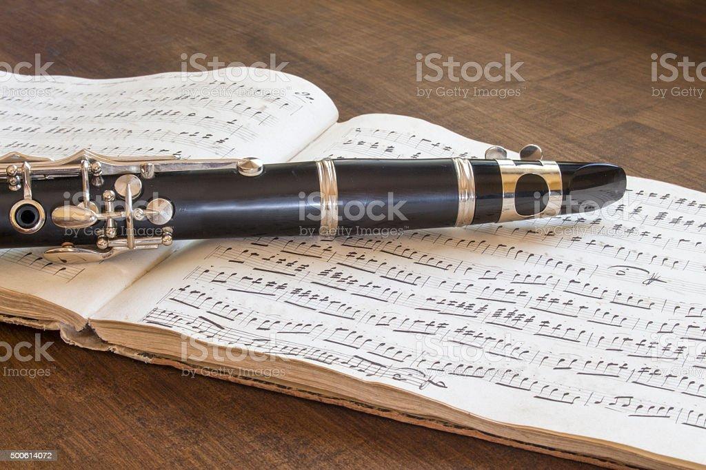 Clarinet and musical score stock photo