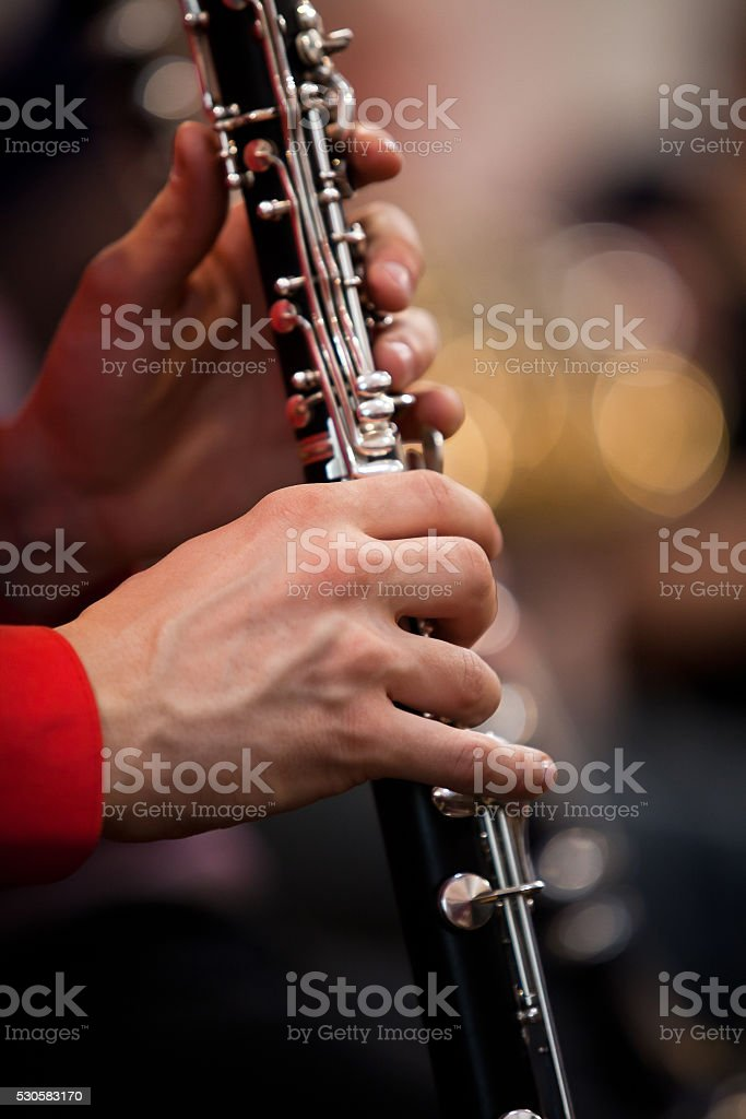 Clarinet in the hands of a musician stock photo