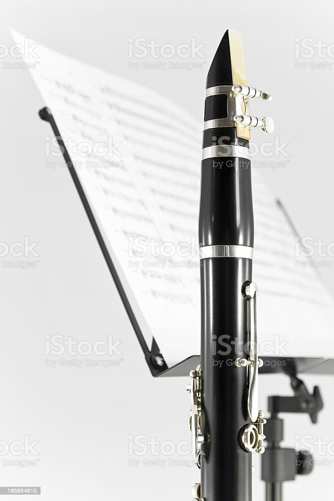 Clarinet learning with clarinet musical instrument and sheet music royalty-free stock photo