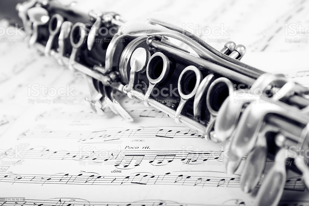 Clarinet on sheet music stock photo