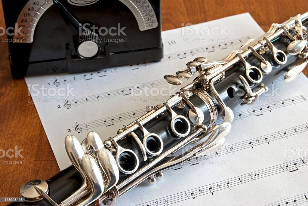 Clarinet on the table with music and metronome royalty-free stock photo