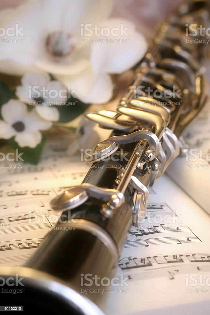 clarinet with white flowers on music royalty-free stock photo