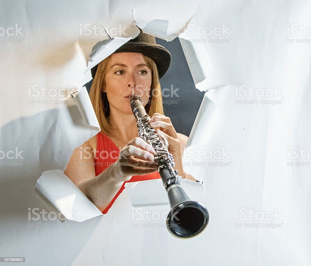 Clarinetists Playing Through Paper Frame stock photo