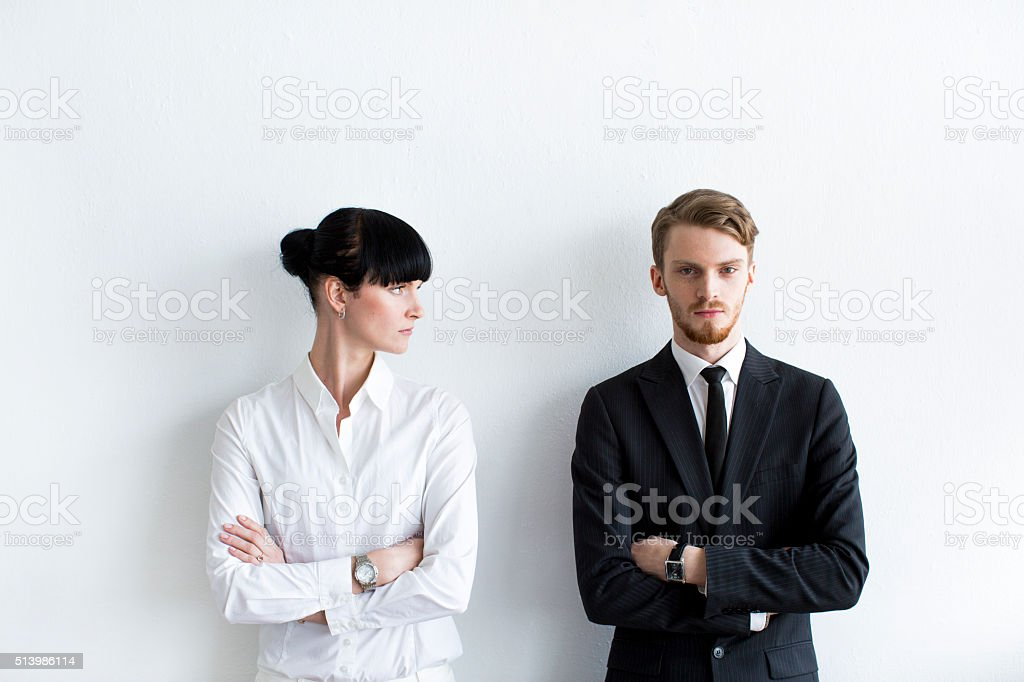 Clash of Gender Roles in Business stock photo