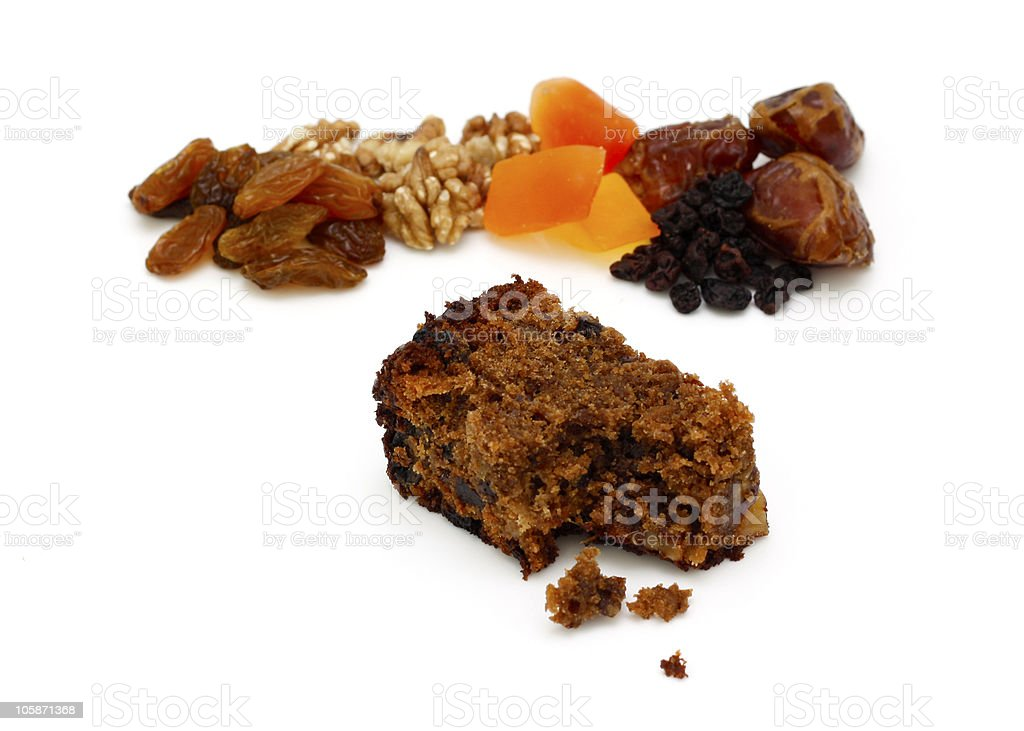 Clasic Fruit Cake with Ingredients in Background royalty-free stock photo