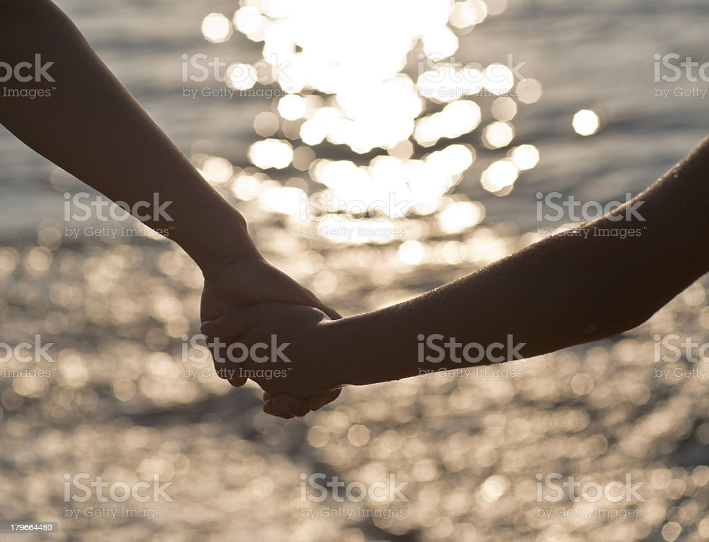 clasping hands royalty-free stock photo