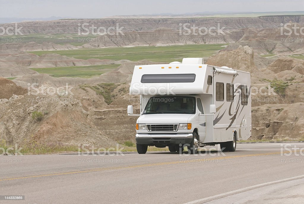 RV class C climbing scenic mountain road in the Badlands stock photo