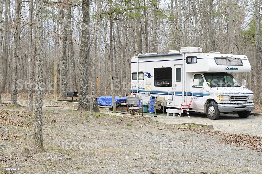 Class c motorhome in campground stock photo