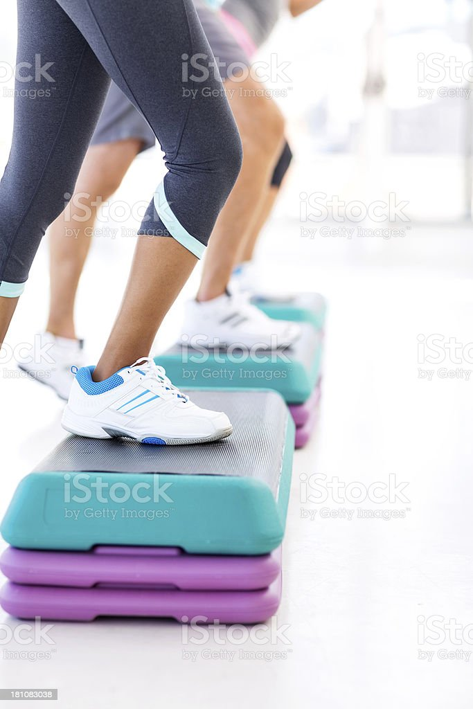 Class Doing Step Aerobics In Health Club royalty-free stock photo