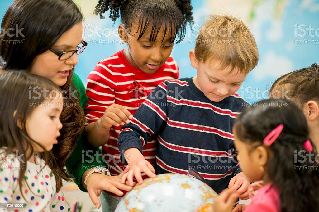 Class Exploring a Globe stock photo