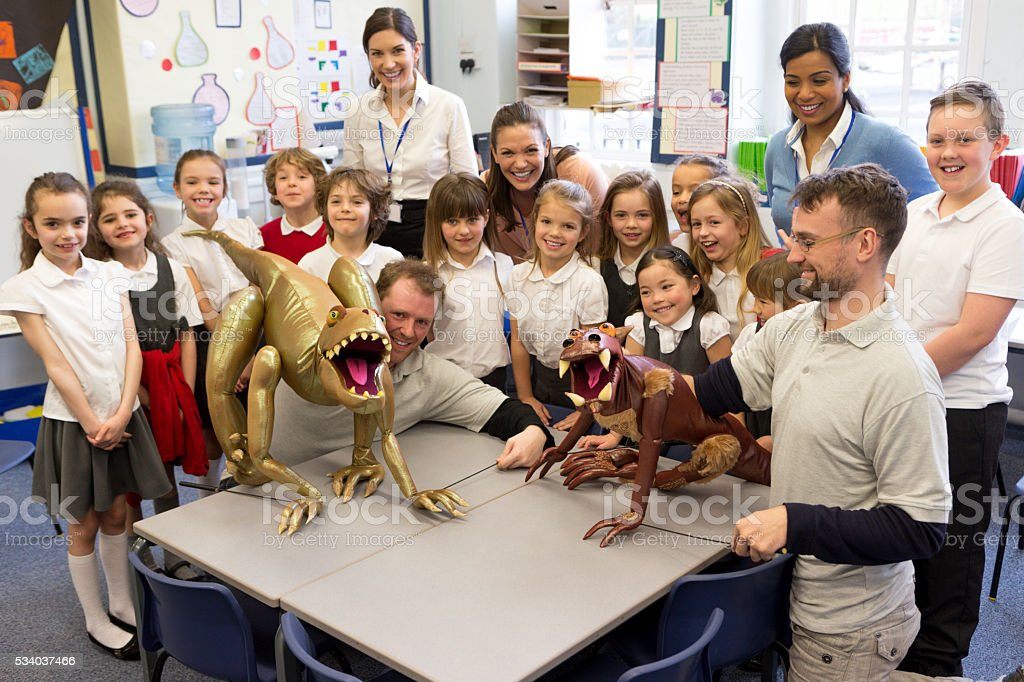 Class learning through puppets stock photo