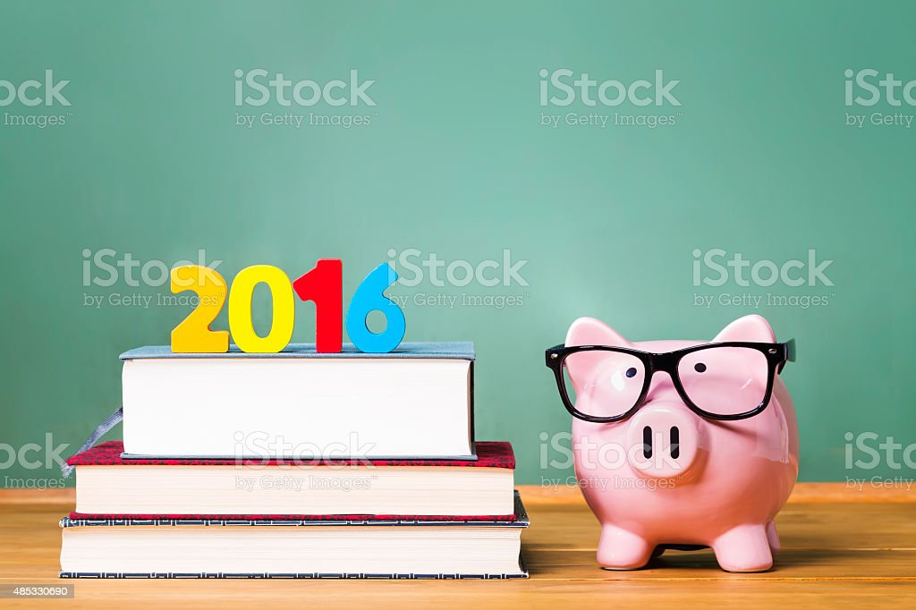 Class of 2016 theme with textbooks and piggy bank stock photo