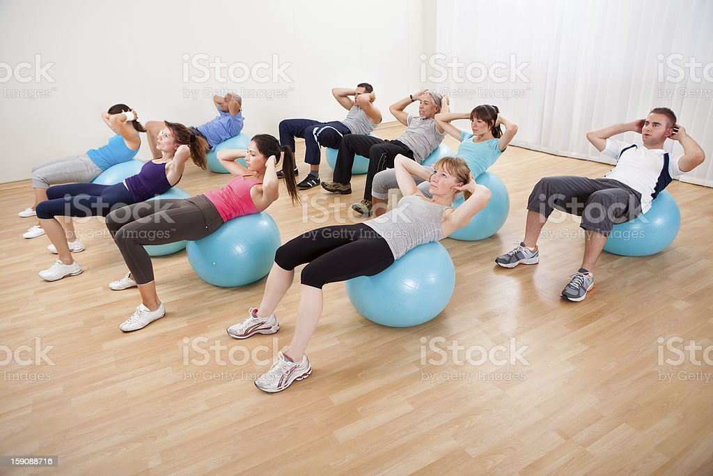 Class of diverse people doing pilates royalty-free stock photo