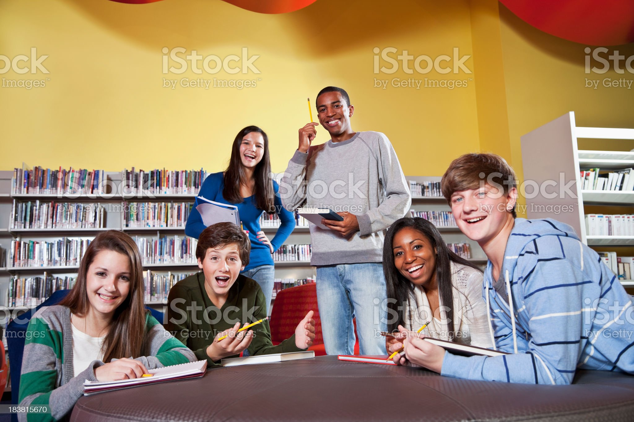 Class of teenage students in library royalty-free stock photo