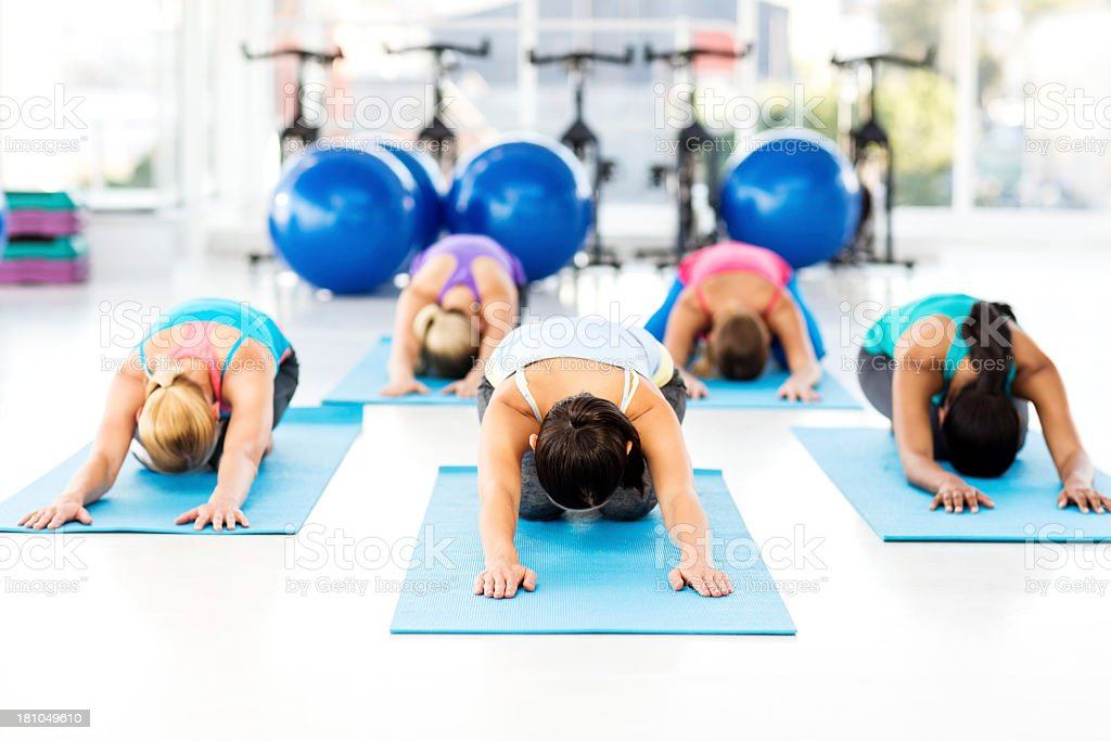 Class Practicing Yoga Exercise In Health Club royalty-free stock photo