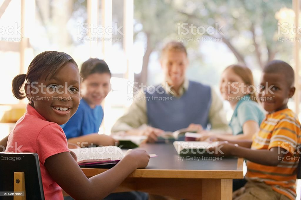 ‡Class reading together stock photo