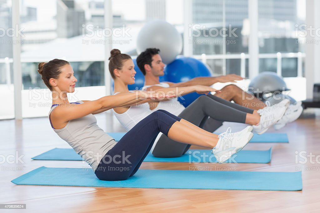 Class stretching on mats at yoga class stock photo