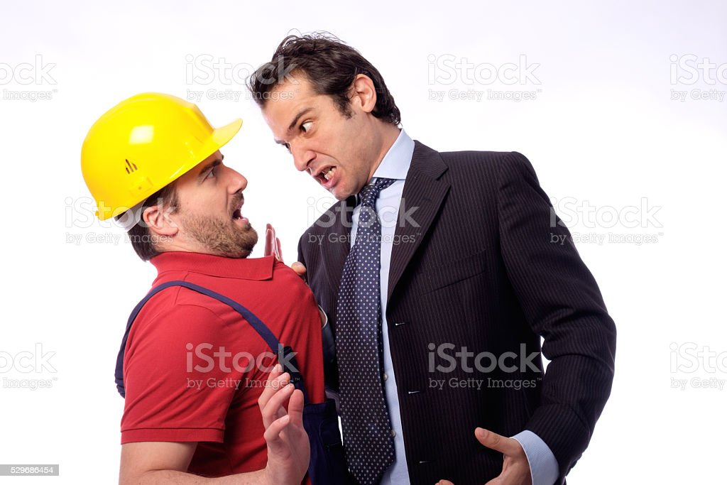 Class struggle between manager and worker stock photo