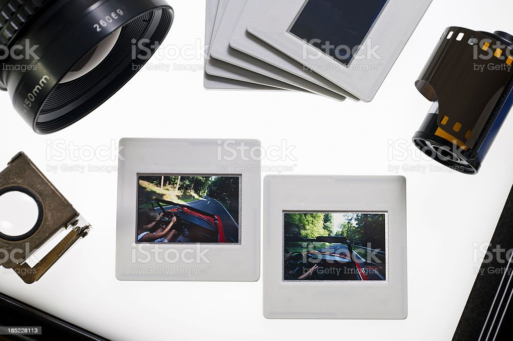 Classic 35 mm slides on a lightbox royalty-free stock photo