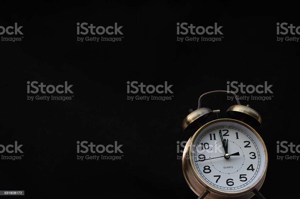 Classic Alarm Clock isolated on black stock photo