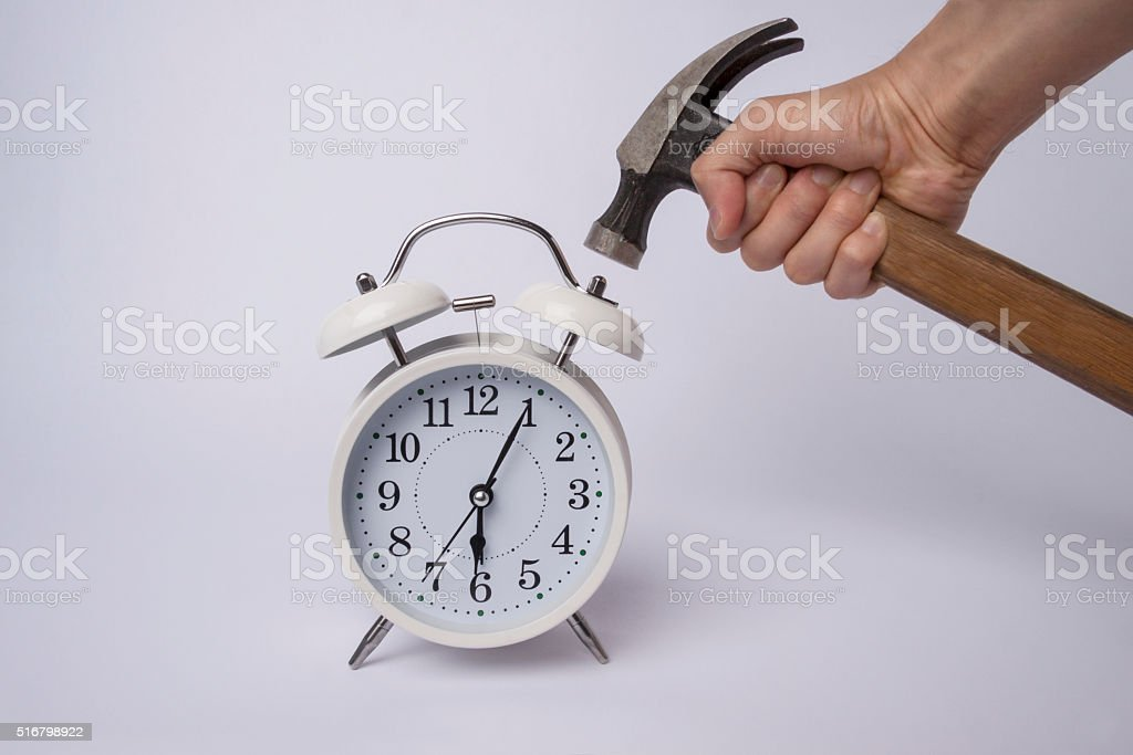 Classic alarm clock with hammer stock photo