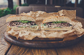 Classic american burgers, fast food on wood background