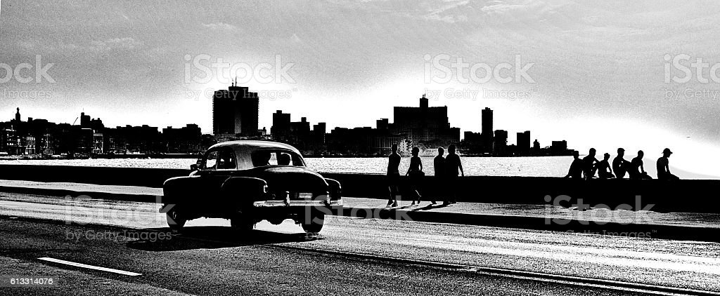 Classic American car driving along the Malecon in Havana. stock photo