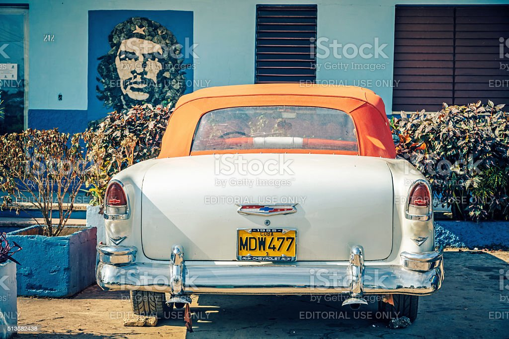 Classic American Car parked in front of Che picture stock photo