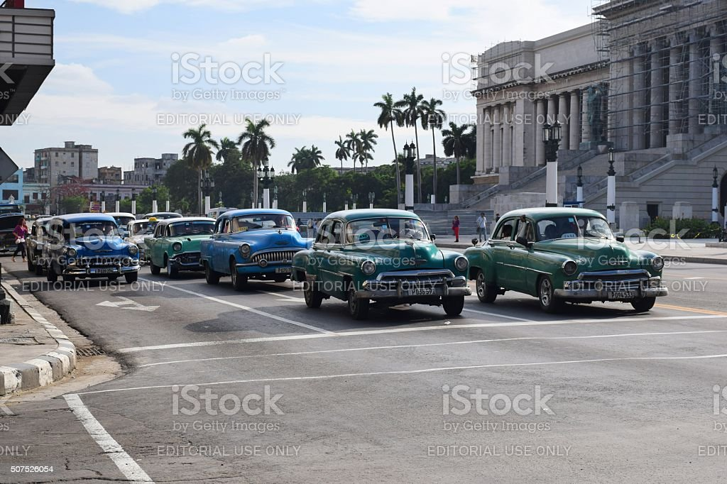 Classic American cars driving on the street in Havana stock photo