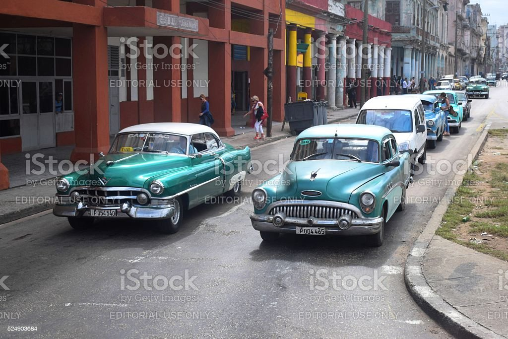 Classic American vehicles driving on the street in Havana stock photo