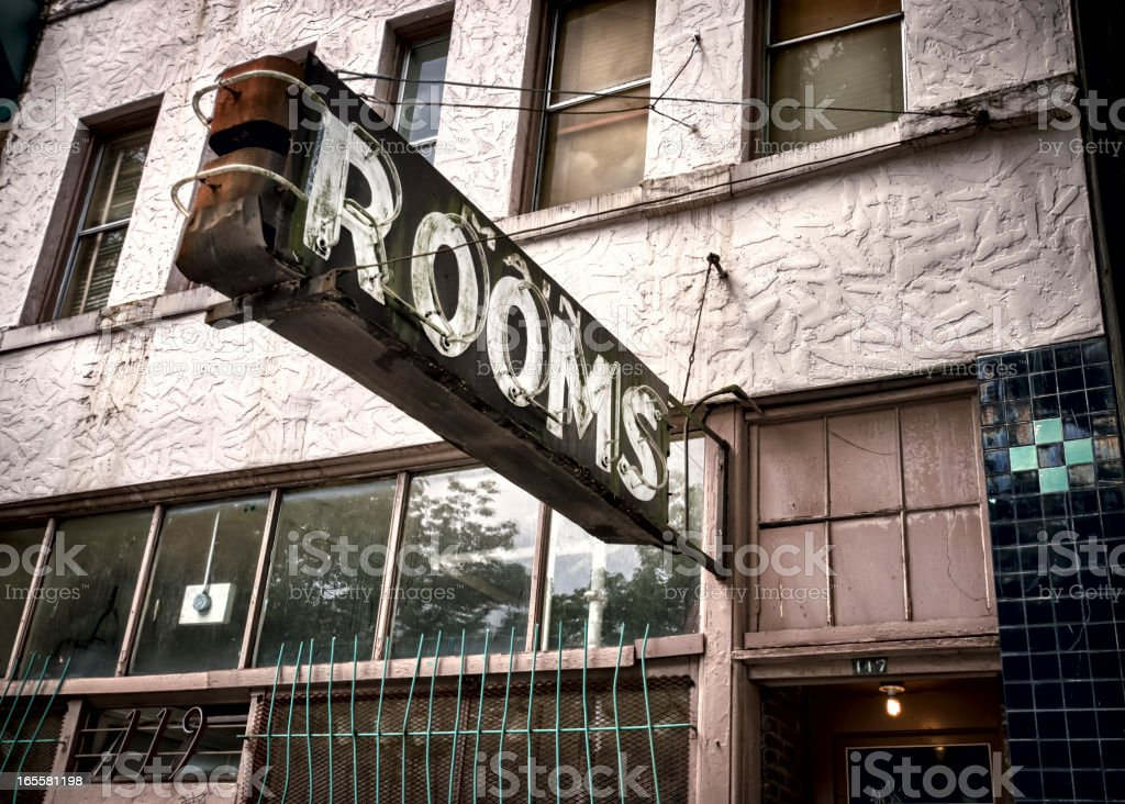 Classic Americana Decaying Neon Rooms for Rent Sign royalty-free stock photo