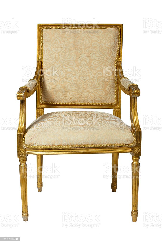 Classic ancient armchair with golden wood  isolated stock photo