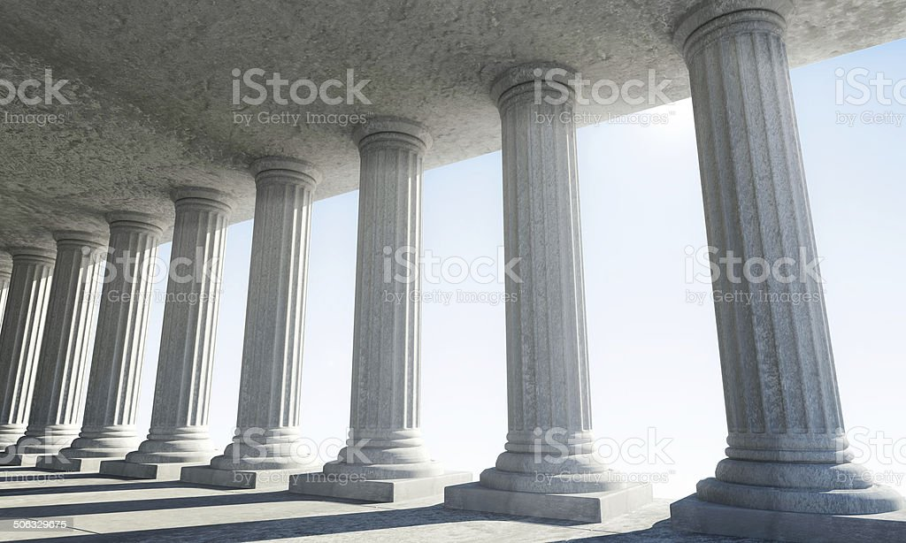 Classic Ancient Interior with sun rays breaking through a columns stock photo