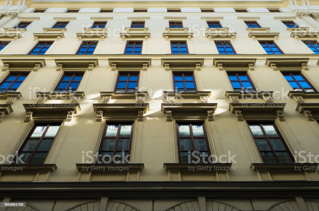 Classic apartment building front facade in Old Town Vienna stock photo