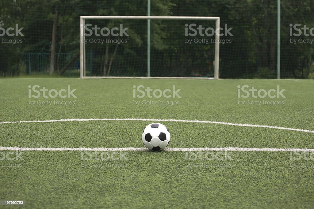 Classic ball for playing soccer on sports ground royalty-free stock photo