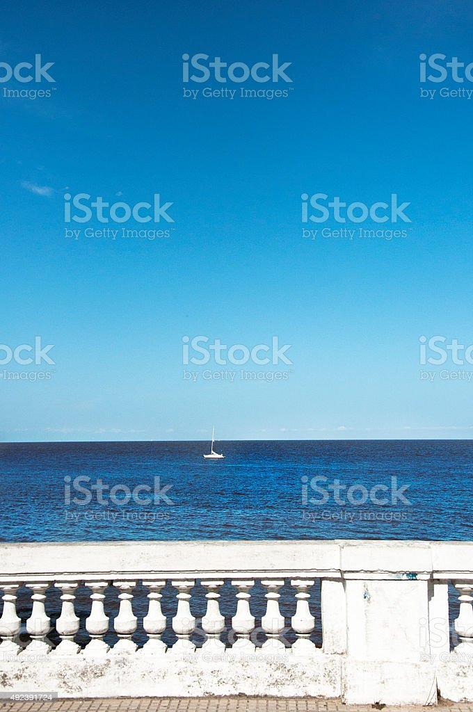 Classic balustrade with sea views and a sailing boat stock photo