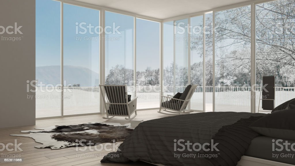 Classic bedroom, minimalistic white interior design, big windows with winter landscape, hotel, spa, resort stock photo