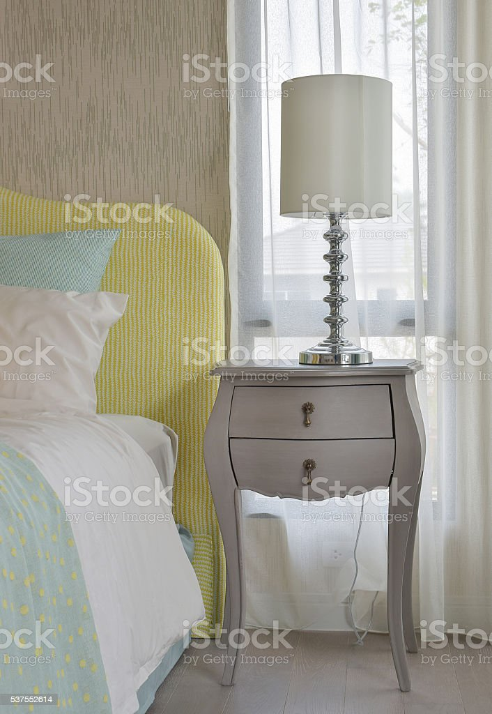 Classic bedside table with reading lamp stock photo