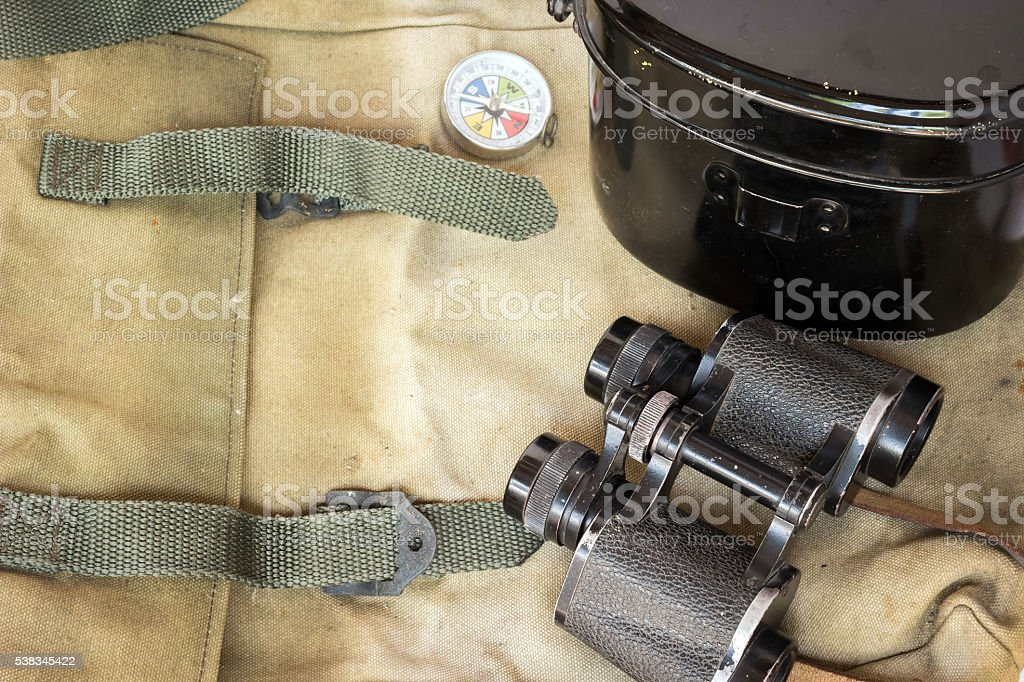 Classic binoculars and compass with army food container stock photo