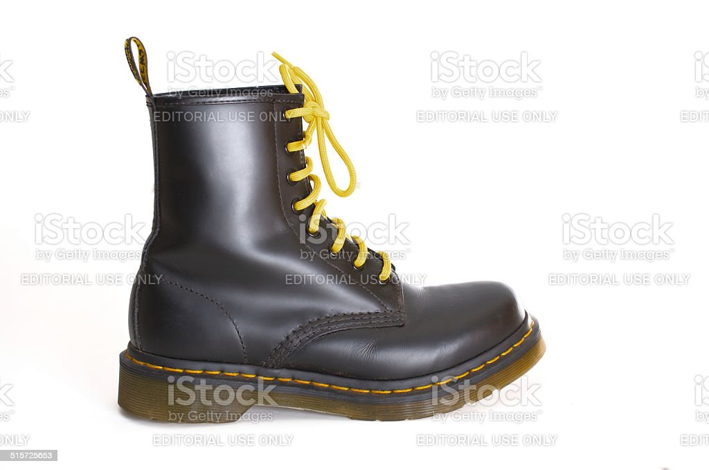 Classic black Dr. Martens lace-up boot with yellow laces stock photo