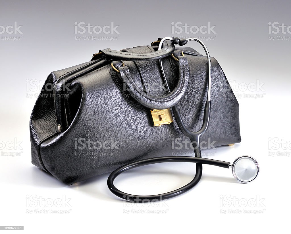 Classic black leather doctor's bag with draped stethoscope stock photo