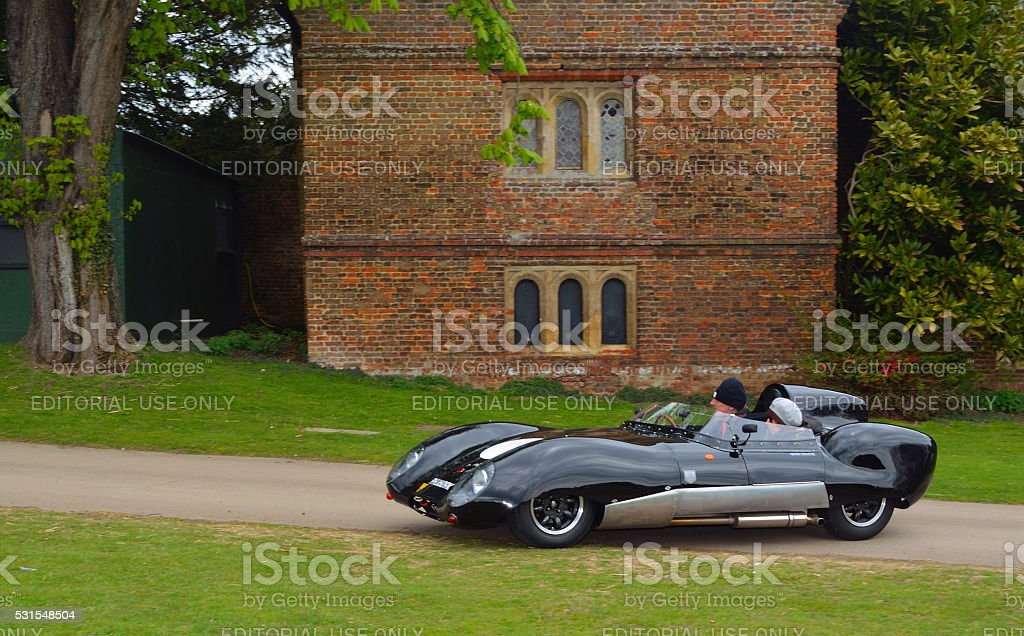 Classic Black Lotus racing car in front of old building. stock photo