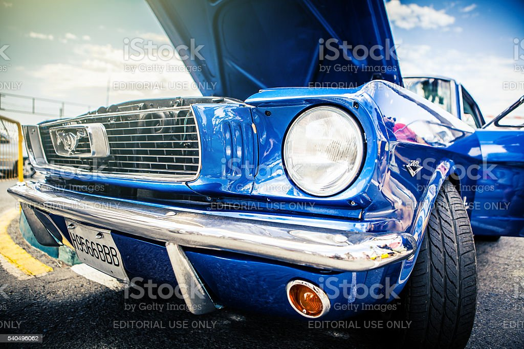 Classic blue Ford Mustang with opened hood. stock photo