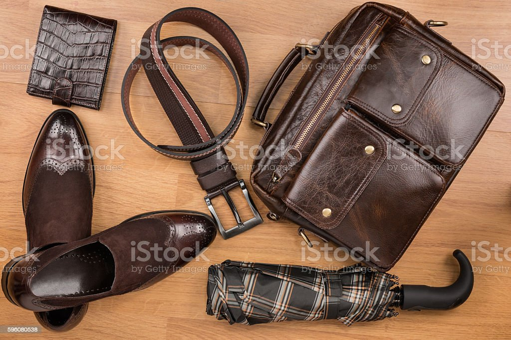 Classic brown shoes, briefcase, belt and umbrella stock photo