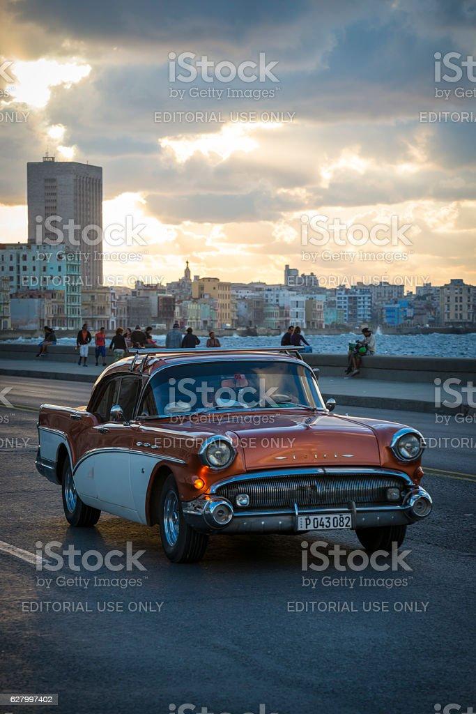 Classic Buick car on Havana's Malecon at sunset stock photo