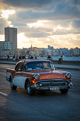 Classic Buick car on Havana's Malecon at sunset
