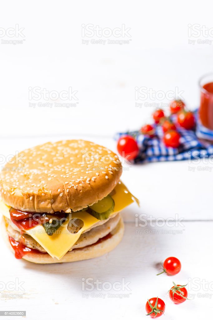 classic burger on a wooden table stock photo
