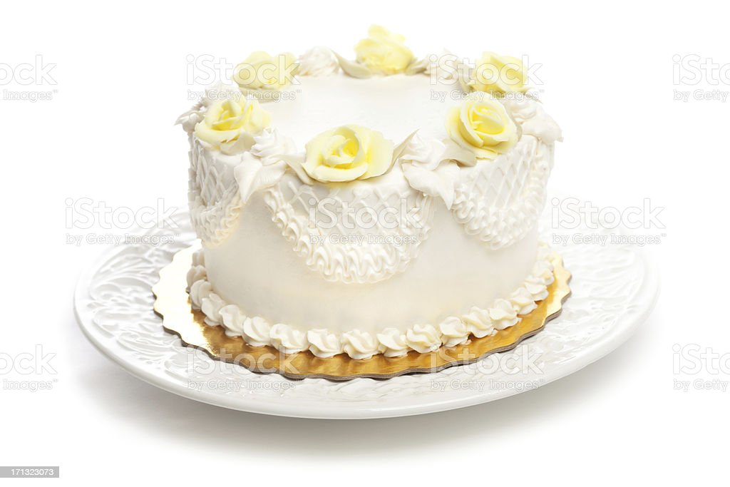 Classic Cake with White Icing and Yellow Rose Decoration Hz royalty-free stock photo